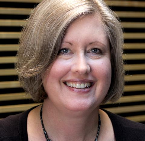 Studio headshot of Sonya Woods
