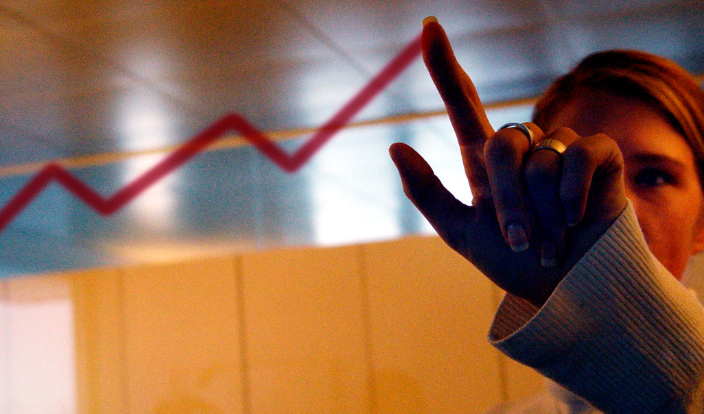 A businesswoman working with a line chart.