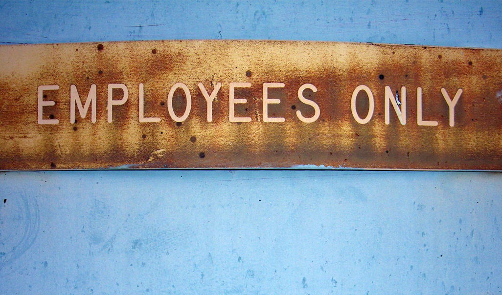 "Decorative sign that says ""Employees Only"""